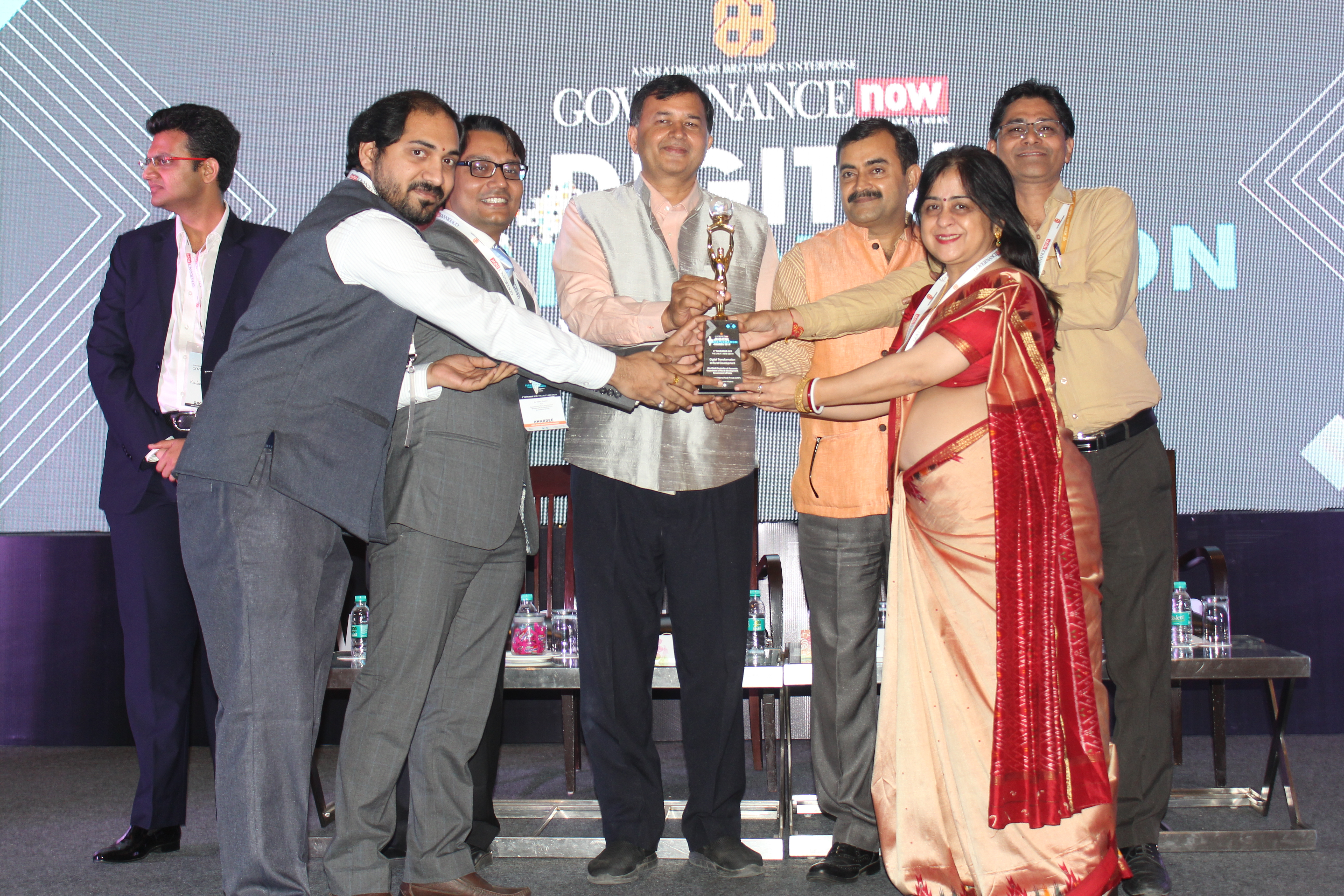 Sh. Ajay S. Sigh CCA, MoRD, PR, DWS & LR and his team receiving the award at the hands of Shri S N Tripathi, Director, Indian Institute of Public Administration