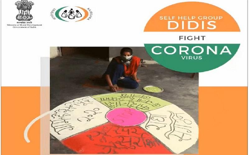 "A powerful message ""Stay Home Stay Safe"" on Covid-19 delivered through a beautiful rangoli made by Radha Village Organisation, village Hasnpur, district Bijnor, Uttar Pradesh"