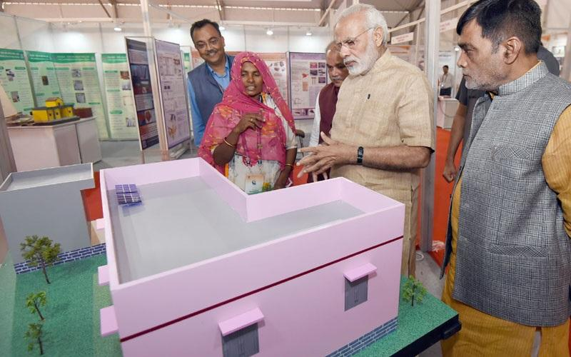 The Hon'ble Prime Minister, Shri Narendra Modi visiting an exhibition on theme 'Technology & Rural life', on the Birth Centenary Celebrations of Nanaji Deshmukh, at IARI, in New Delhi on October 11, 2017 with Hon'ble Minister of Rural Development, Shri Narendra Singh Tomar and Hon'ble Minister of State for Rural Development and Land Resources Shri Ram Kripal Yadav
